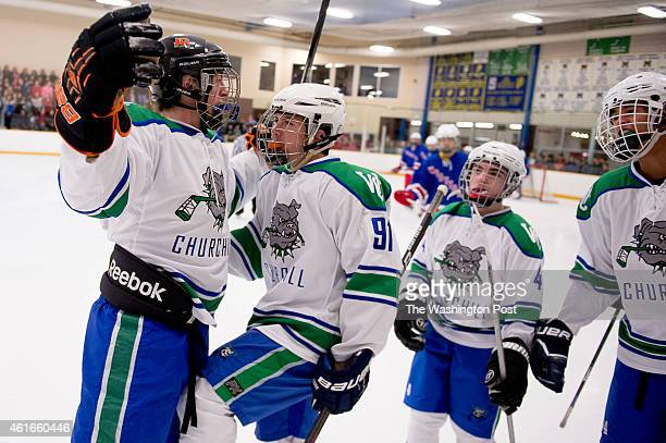 Churchill Forward Mark Weinstein center congratulates Jacob Arden left after he scores the first goal of the game as Wootton plays Churchill in high...