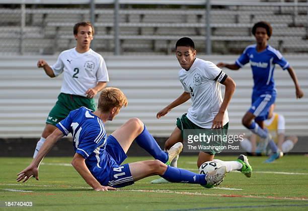 Churchill's JJ Van Der Merwe slides to take the ball away from Walter Johnson's Jorge Sanchez during the game at Walter Johnson High School on...