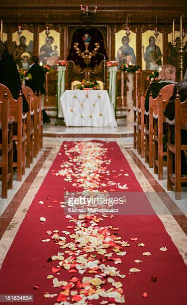 church's aisle covered in rose petals - church wedding decorations stock pictures, royalty-free photos & images
