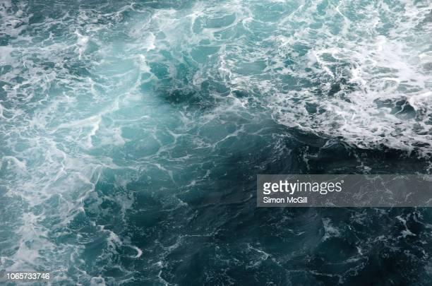 churning seascape in strong winds - wasseroberfläche stock-fotos und bilder