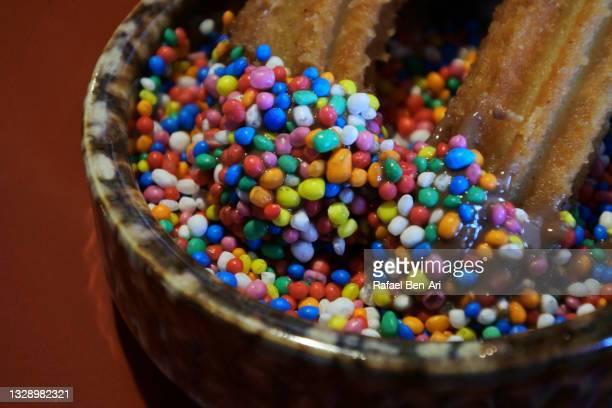 churro pastry served with milk chocolate - rafael ben ari - fotografias e filmes do acervo