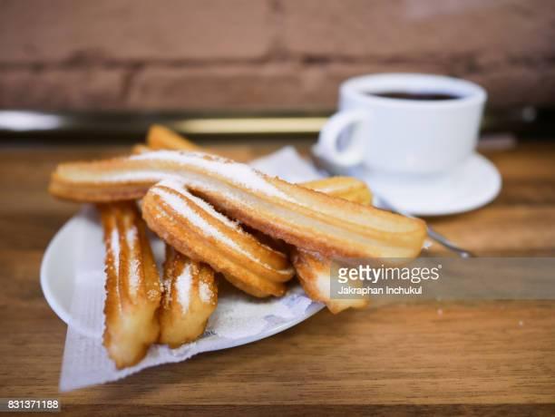 churros and hot chocolate - churro fotografías e imágenes de stock
