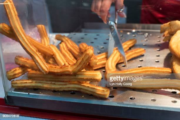 churros for sale in lisbon portugal - lyn holly coorg stock pictures, royalty-free photos & images