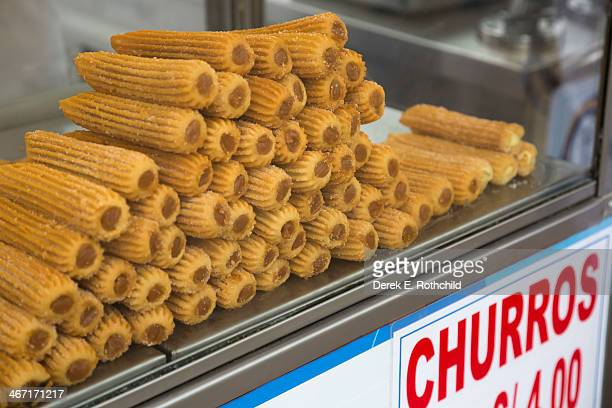 churros on food cart for sale - churro fotografías e imágenes de stock