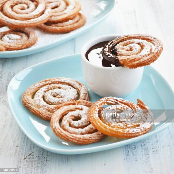 churros whirls with a chocolate dip - churro stock photos and pictures