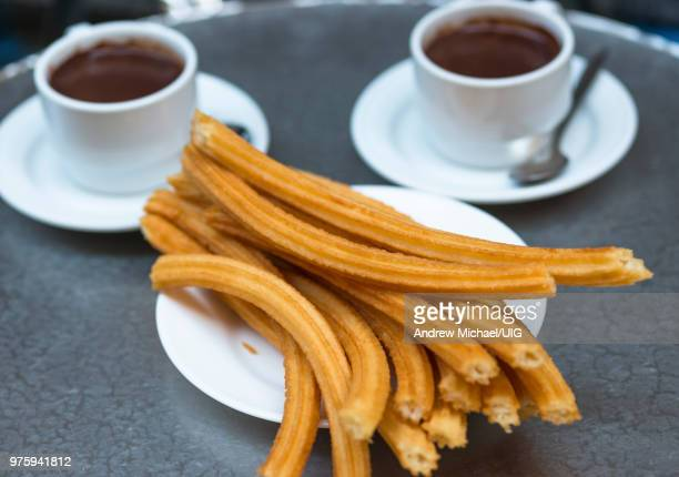 churros with chocolate, a typical spanish sweet snack, madrid - churro fotografías e imágenes de stock