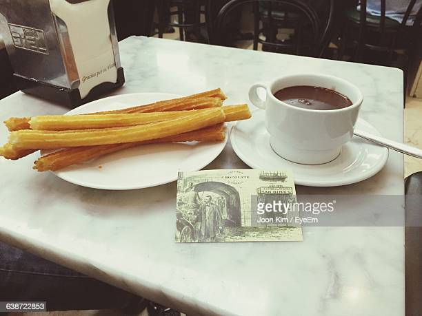 Churros With Chocolate On Table In Restaurant