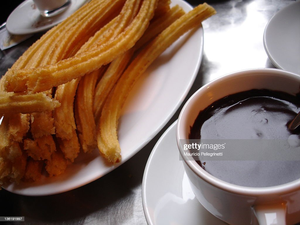 Churros with chocolate : Stock Photo