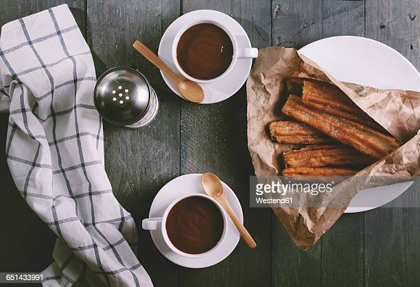 churros with cups of hot chocolate - churro stock photos and pictures