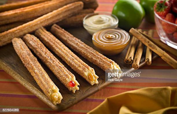 Churros with fillings on cutting board