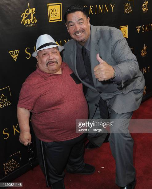 Chuy Bravo and Lou Pizarro arrive for Donna D'Errico's Celebration of The Launch Of Skinny Cannabis Vape held at The District by Hannah An on June...