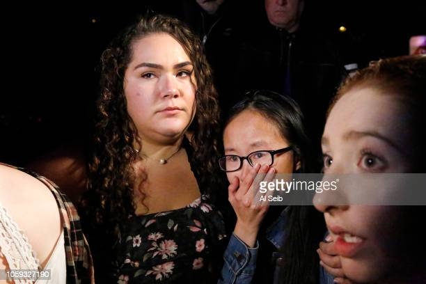 Chyann Worrell Nellie Wong and Erika Sigman left to right react talking to media and friends outside the shooting scene at the Borderline mass...