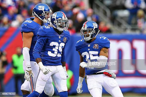 Chykie Brown and Quintin Demps of the New York Giants celebrate after a play against the San Francisco 49ers at MetLife Stadium on November 16, 2014...