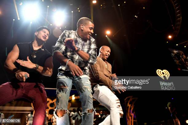 Chyno Miranda and Gente de Zona perform onstage during the iHeartRadio Fiesta Latina Celebrating Our Heroes at American Airlines Arena on November 4...