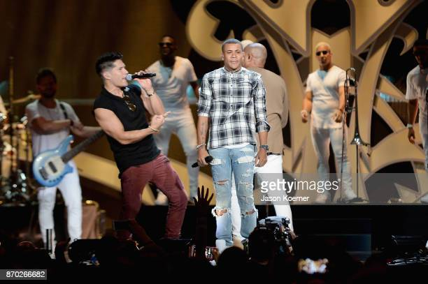 Chyno Miranda and Randy Malcom perform onstage during the iHeartRadio Fiesta Latina Celebrating Our Heroes at American Airlines Arena on November 4...