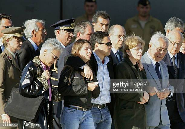 Relatives and friends flanked by Italy's President Giorgio Napolitano stand 07 June 2006 awaiting the arrival of the coffin of Italian soldier...