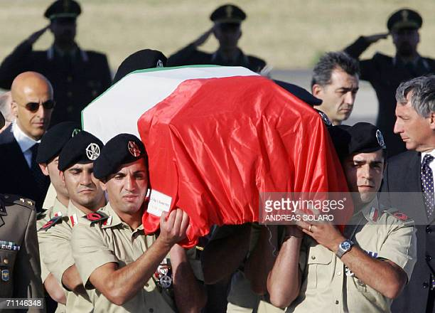 The coffin of Italian soldier Alessandro Pibiri killed in Iraq arrives at Rome's Ciampino military airport 07 June 2006 The Italian soldier was...