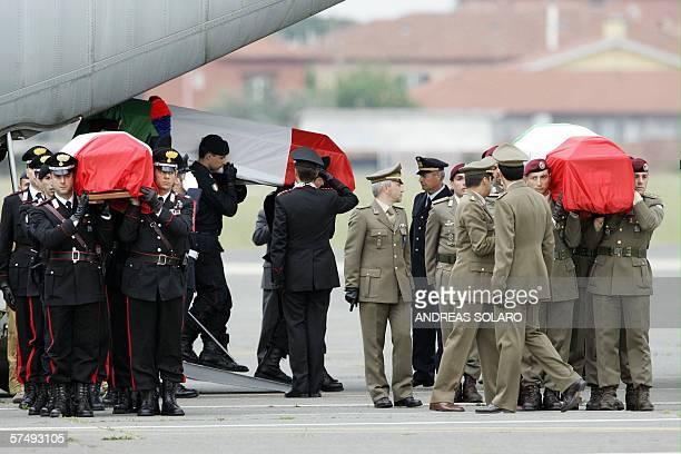 The flagdraped coffins of Franco Lattanzio Nicola Ciardelli and Carlo Di Trizio arrive at Rome's Ciampino airport 29 April 2006 The three Italian...