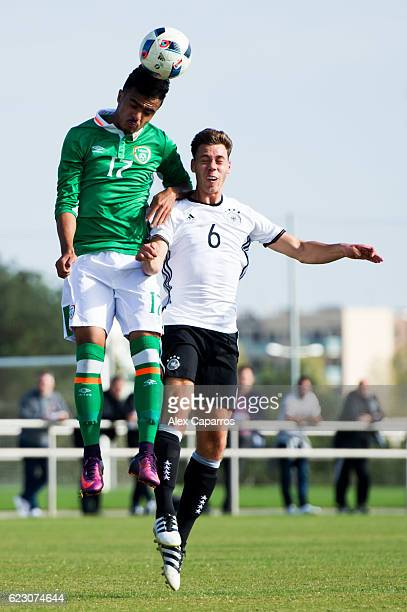 Cian Flanagan of Ireland and Marc Dauter of Germany compete for the ball during the U18 international friendly match between Ireland and Germany on...
