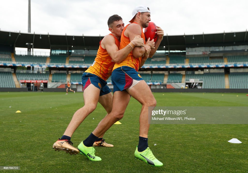 Cian Hanley of the Lions tackles teammate Luke Hodge during the Brisbane Lions AFL pre-season training session at University of Tasmania Stadium on December 19, 2017 in Launceston, Australia.