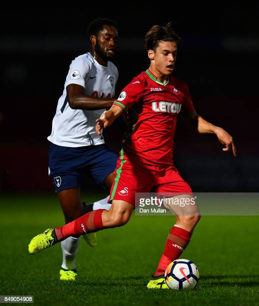 Cian Harries of Swansea City holds off Christian Maghoma of Tottenham Hotspur during the Premier League 2 match between Tottenham Hotspur and Swansea...