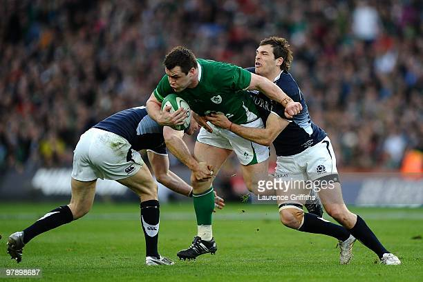 Cian Healy of Ireland is tackled by Sean Lamont and Graeme Morrison of Scotland during the RBS Six Nations match between Ireland and Scotland at...