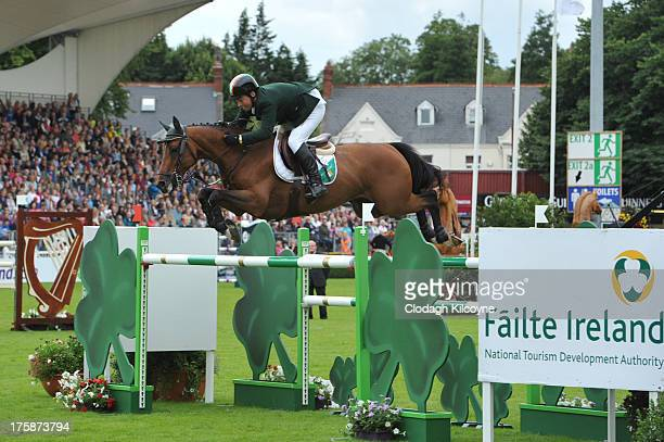 Cian O'Connor and Blue Lloyd jump the final fence for the Aga Khan trophy in the Furusiyya FEI Nations Cup at the RDS Dublin Horse Show at Royal...