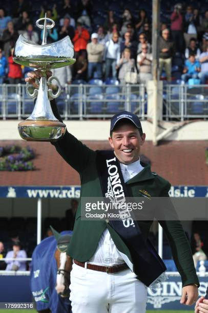 Cian O'Connor of Ireland celebrates with the trophy after winning on Blue Loyd 12 the Longines International Showjumping Grand Prix of Ireland with a...