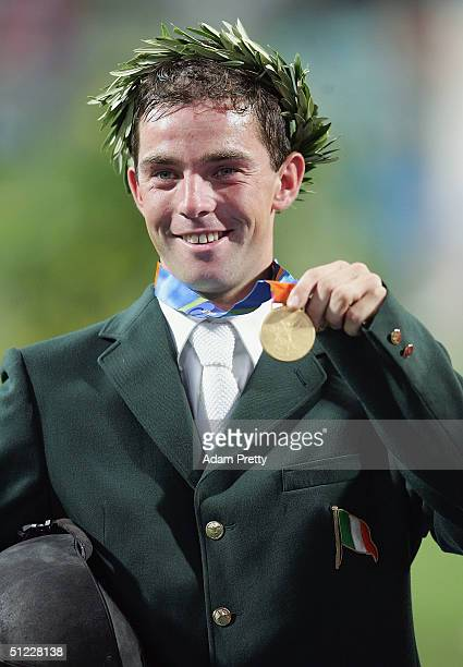 Cian O'Connor of Ireland who rode Waterford Crystal celebrates winning the gold medal in the individual show jumping event on August 27, 2004 during...