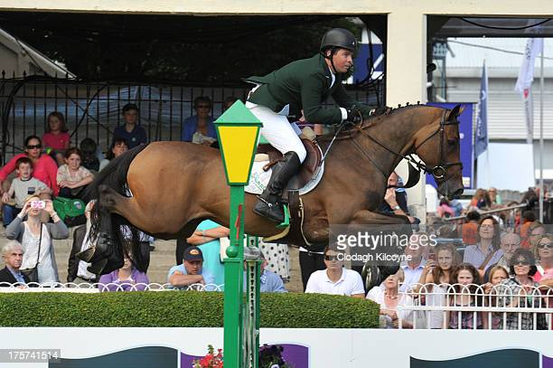 Cian O'Connor on Cooper and of Ireland take part in the RDS Dublin Horse Show 'Irish Sports Council Classic' International Competition in the Main...