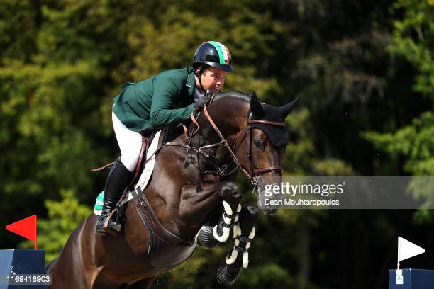 Cian O'Connorn of Ireland riding PSG Final competes during Day 3 of the Longines FEI Jumping European Championship speed competition against the...