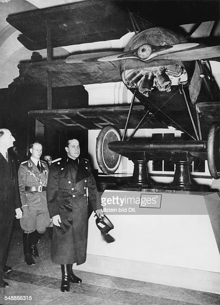 Ciano Galeazzo Politician Italy * in front of the airplane of Manfred von Richthofen at his visit to the Zeughaus in Berlin Photographer Heinz Fremke...