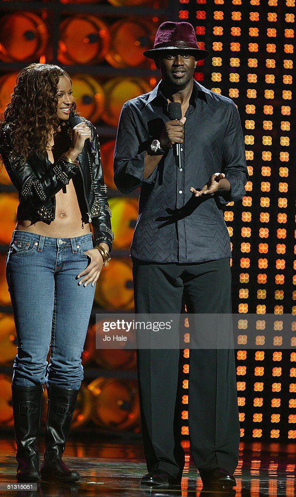 Ciara and Brian McKnight present an award on stage at the 2004 World Music Awards at the Thomas & Mack Centre on September 15, 2004 in Las Vegas.