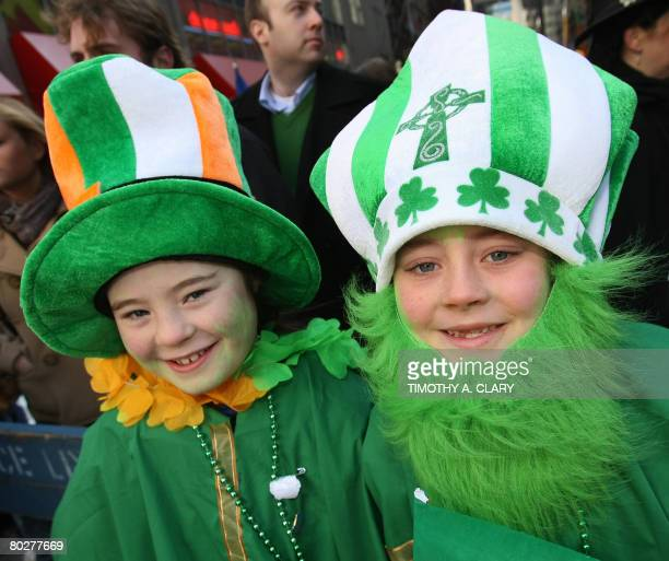 Ciara and Niall Casey dressed in Irish colors cheer on marching bands as they make their way up 5th Avenue during the St Patrick's Day Parade on...