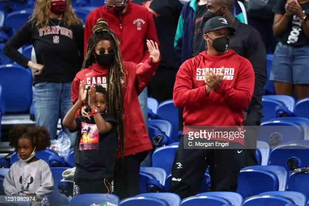 Ciara and Russell Wilson of the Seattle Seahawks celebrate the Stanford Cardinal win over Missouri State Lady Bears in the Sweet Sixteen Round of the...