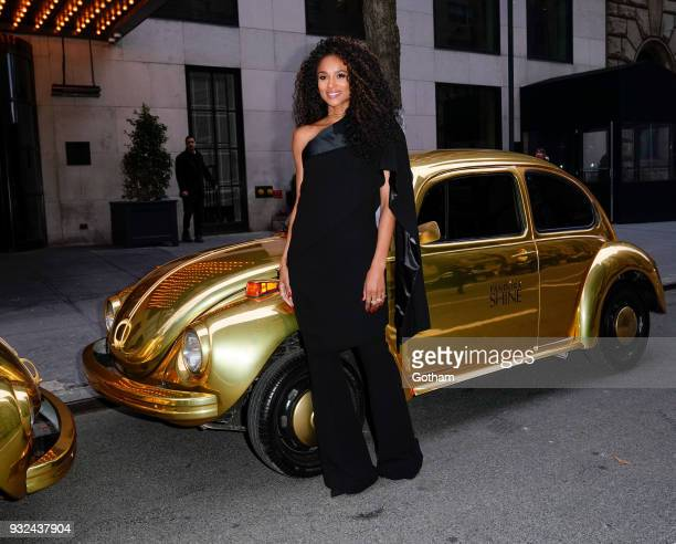Ciara poses for photos in front of dual gold VW Beetles at Pandora Jewelry Shine collection launch on March 14 2018 in New York City