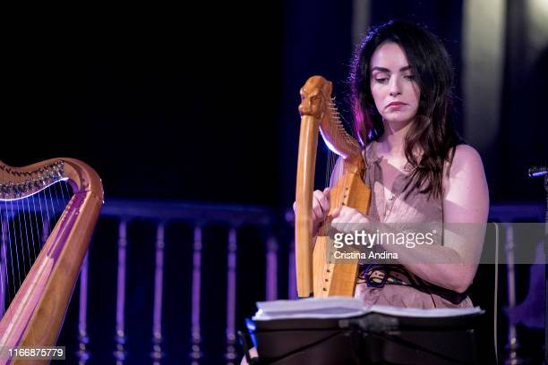 Ciara Taaffe harp and lyre of Carlos Núñez performs on stage in Mondoñedo´s Cathedral on August 02 2019 in Mondoñedo Spain