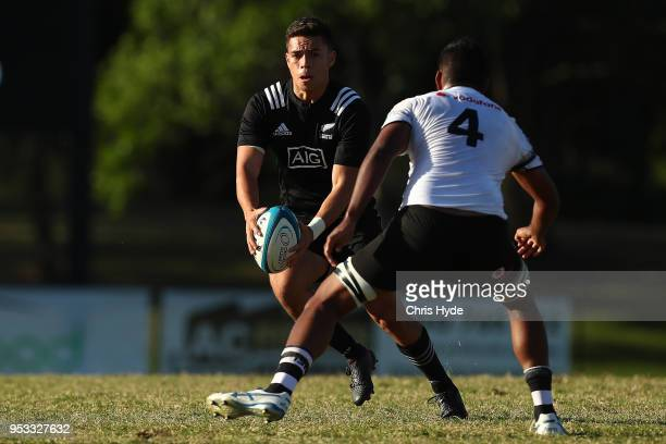 Ciarahn Matoe of New Zealand runs the ball during the 2018 Oceania Rugby U20 Championship match between New Zealand and Fiji at Bond University on...