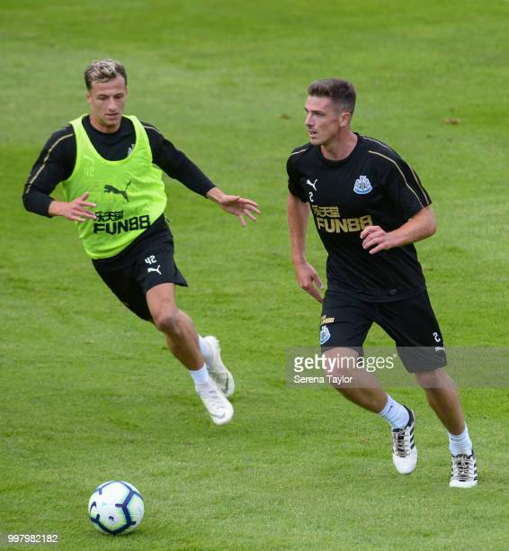 Ciaran Clark controls the ball whilst being challenged by Jamie Sterry during the Newcastle United Training session at Carton House on July 13 in...