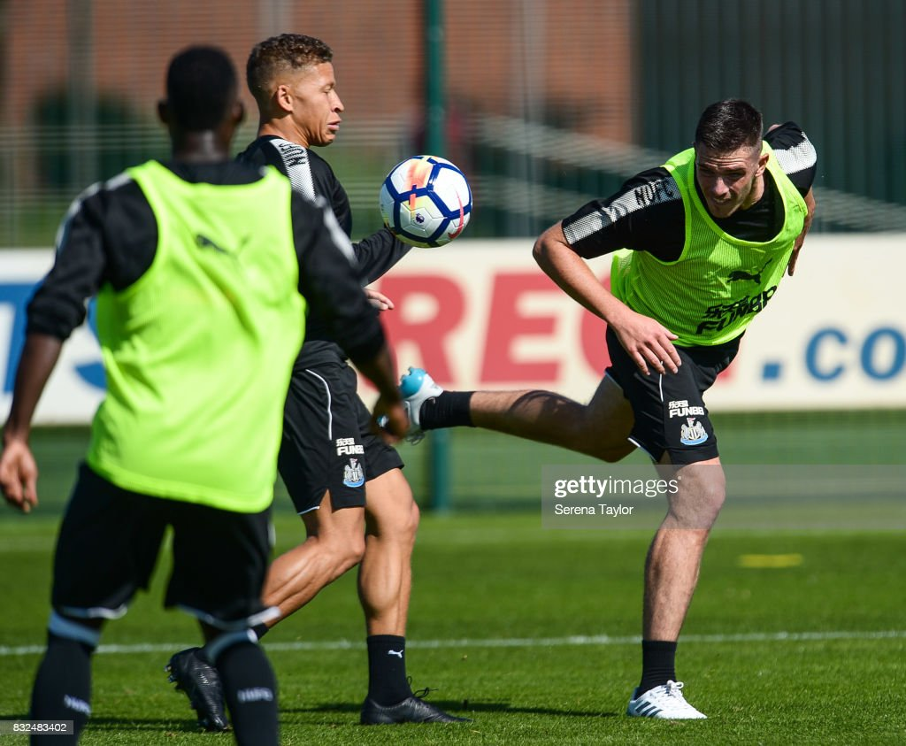 Ciaran Clark (R) heads the ball during the Newcastle United Training session at the Newcastle United Training Centre on August 16, 2017, in Newcastle upon Tyne, England.