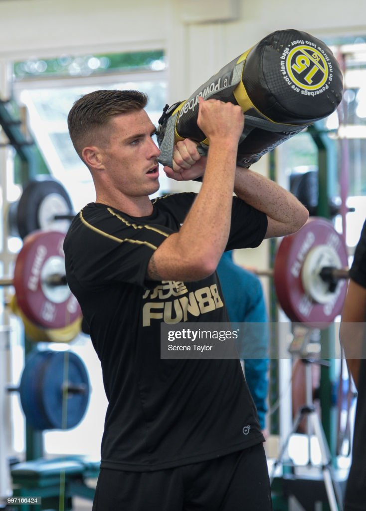Ciaran Clark lifts weight bags during the Newcastle United Training session at Carton House on July 12, 2018, in Kildare, Ireland.