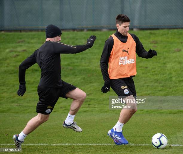 Ciaran Clark looks to challenge Federico Fernandez during the Newcastle United Training Session at the Newcastle United Training Centre on March 22...