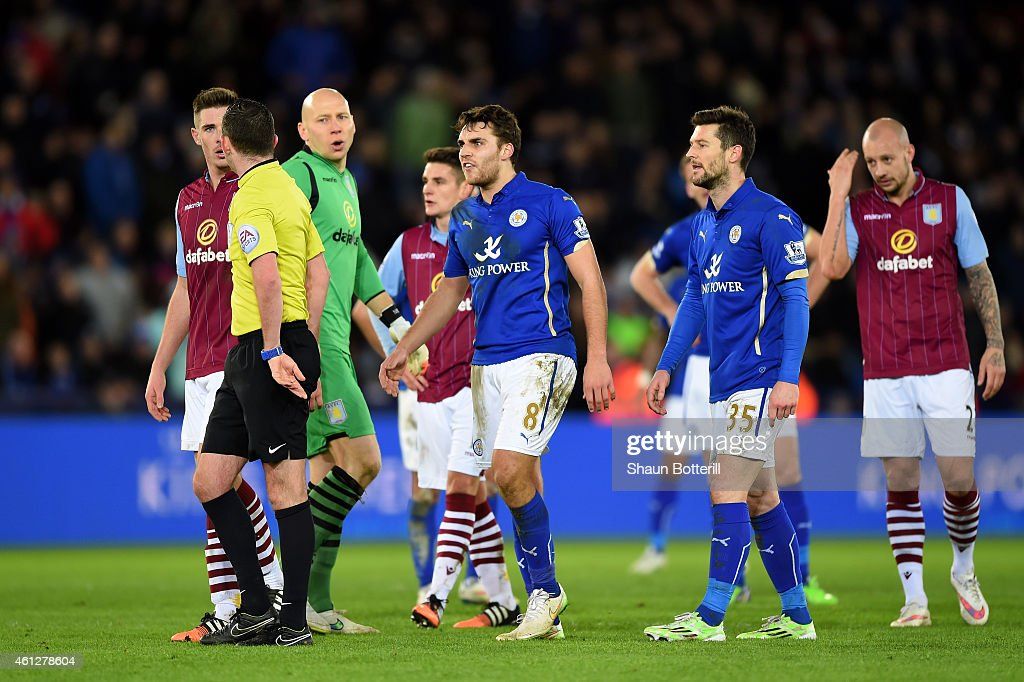 Ciaran Clark of Aston Villa and Matthew James of Leicester City react as they are shown the red card by referee Michael Oliver during the Barclays Premier League match between Leicester City and Aston Villa at The King Power Stadium on January 10, 2015 in Leicester, England.