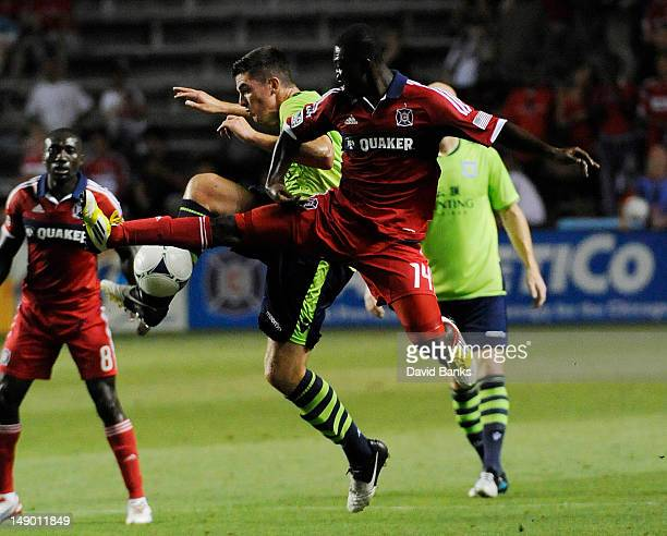 Ciaran Clark of Aston Villa and Patrick Nyarko of the Chicago Fire fight for the ball during the second half of international friendly match on July...