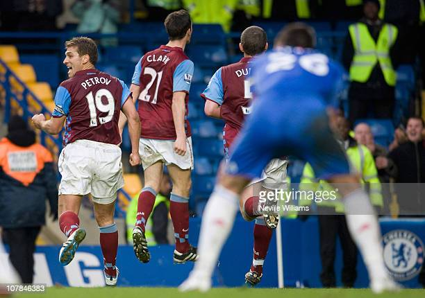 Ciaran Clark of Aston Villa celebrates with his team mates after scoring his team's third goal during the Barclays Premier League match between...