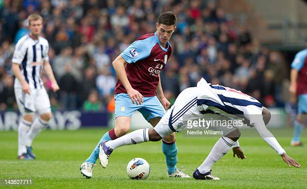 Ciaran Clark of Aston Villa challenged by Youssouf Mulumbu of West Bromwich Albion during the Barclays Premier League match between West Bromwich...