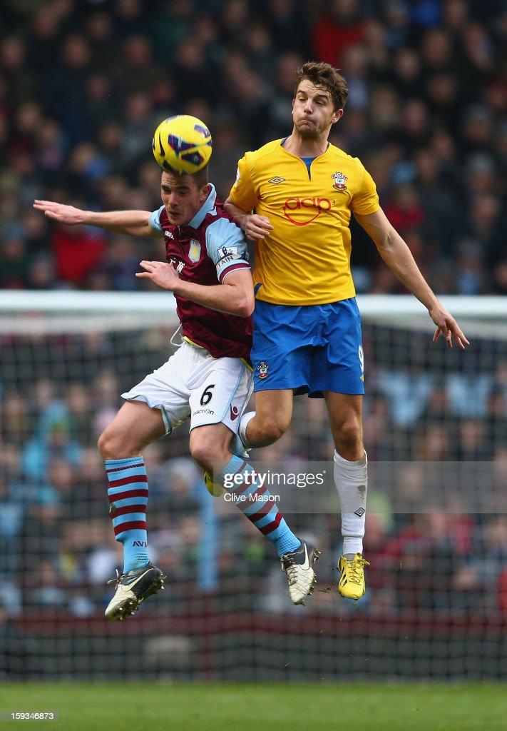 Ciaran Clark of Aston Villa holds off a challenge from Jay Rodriguez of Southampton during the Barclays Premier League match between Aston Villa and Southampton at Villa Park on January 12, 2013 in Birmingham, England.