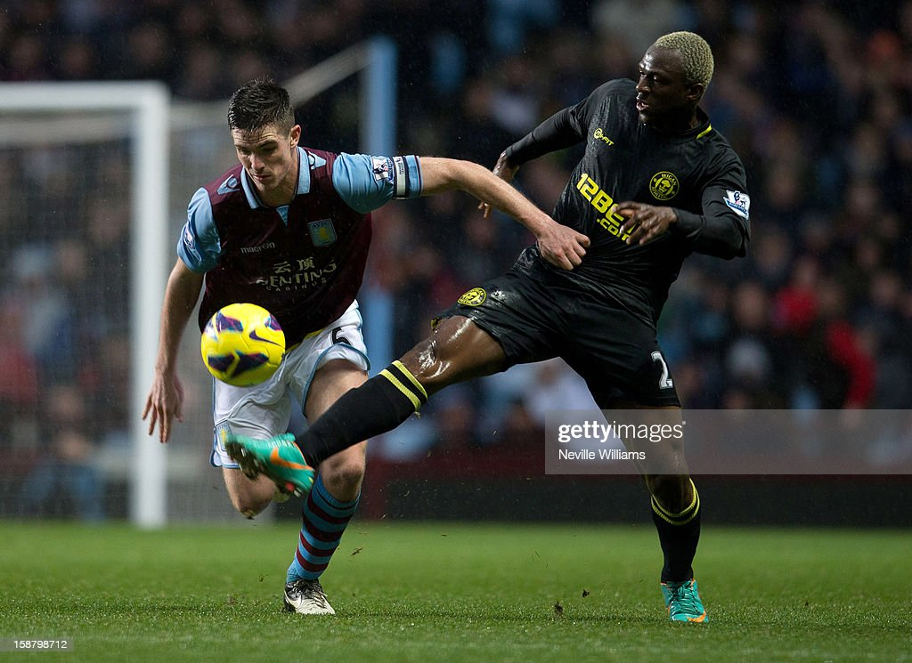 Ciaran Clark (L) of Aston Villa in action with Arouna Kone of Wigan Athletic during the Barclays Premier League match between Aston Villa and Wigan Athletic at Villa Park on December 29, 2012 in Birmingham, England.