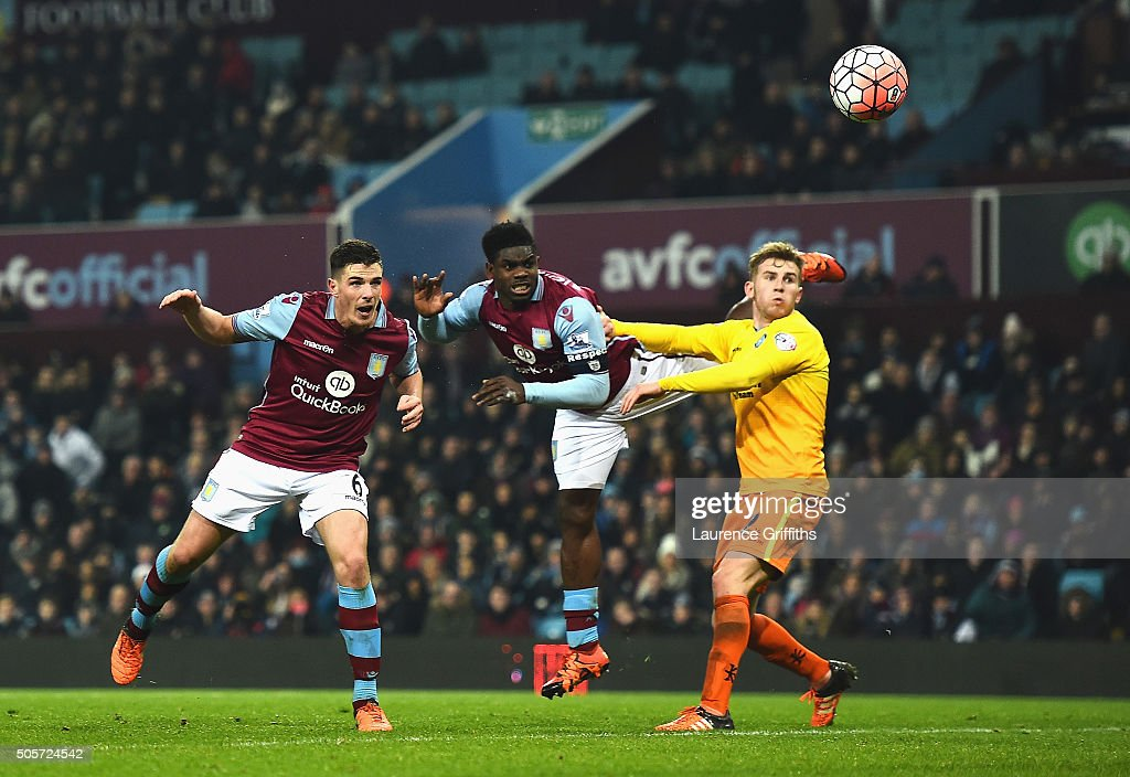 Ciaran Clark (L) of Aston Villa scores his team's first goal during the Emirates FA Cup Third Round Replay match between Aston Villa and Wycombe Wanderers at Villa Park on January 19, 2016 in Birmingham, England.