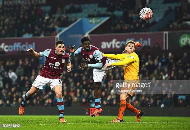 Ciaran Clark of Aston Villa scores his team's first goal during the Emirates FA Cup Third Round Replay match between Aston Villa and Wycombe...